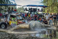 4x4 vehicle entering water at speed stock photos