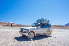 4x4 vehicle taking tourists on the desertic highlands of the Andes in Huayllajc, Bolivia, ro Stock Photo