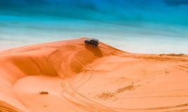 4x4 vehicles and dunes. Driving 4x4 vehicles on the dunes royalty free stock photography