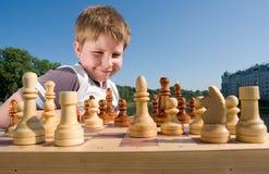Xadrez do menino Fotografia de Stock