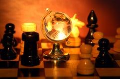 Xadrez e mundo imagem de stock