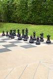 Xadrez no jardim Fotografia de Stock Royalty Free