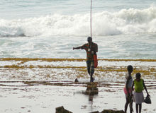 Xai-Xai, Mozambique - December 11, 2008: the Family fishing. Royalty Free Stock Photos