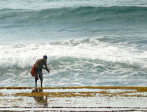 Xai-Xai, Mozambique - 11 December 2008: Unknown man catches the Stock Image