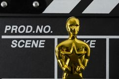 Plastic Oscar award and clapboard stock photo
