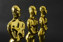 Plastic Oscar awards. XALAPA, VERACRUZ, MEXICO- FEBRUARY 14, 2019: Plastic Oscar awards against black background royalty free stock image