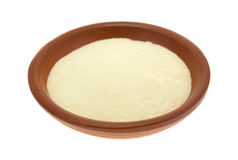 Xanthan gum in a small bowl. A portion of gluten free xanthan gum in a small bowl isolated on a white background Stock Images