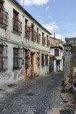 XANTHI, GREECE - SEPTEMBER 23, 2017: Street and old houses in old town of Xanthi, Greece. XANTHI, GREECE - SEPTEMBER 23, 2017: Street and old houses in old town royalty free stock photos