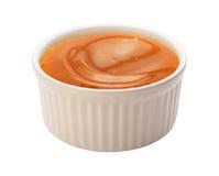 Xarope do caramelo em um Ramekin Fotos de Stock