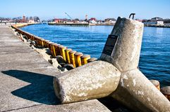 Xaver storm tetrapod at Darlowko port entrance. Detail of a large concrete five-ton tetrapod (gwiazdoblok) thrown onto the jetty of Darlowo (Darlowko, Poland) Stock Photo