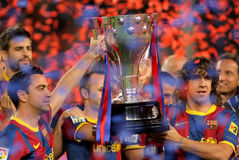 Xavi anbd Puyol hold La Liga Trophy. Xavi Hernandez and Carles Puyol of FC Barcelona hold the La Liga trophy after the match between Barcelona and Deportivo La royalty free stock image
