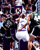 Xavier McDaniel and Charles Barkley. Celtics power forward Xavier McDaniel battles Charles Barkley for a rebound. (Image taken from color negative Royalty Free Stock Photos