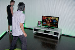 Xbox 360 and Kinect with Dance Central. COLOGNE - AUGUST 17: Videogamers playing with Dance Central for Kinect on Xbox 360 at GamesCom 2010, the most important Royalty Free Stock Image