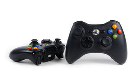Xbox game controller. Black microsoft xbox game controllers for the Xbox 360 console Royalty Free Stock Photo