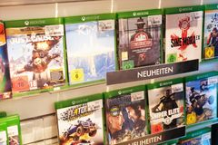 Xbox games in electronics store. Mannheim, Germany - August 23, 2017: Xbox games in electronics store. Xbox is a line of home video game consoles developed by Royalty Free Stock Photos
