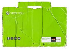 XBox 360 green cardboard packaging. Isolated on white ground royalty free stock images