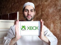 Xbox logo. Logo of Xbox game on samsung tablet holded by arab muslim man Royalty Free Stock Photo