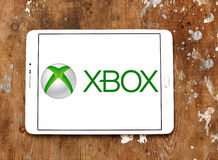 Xbox logo. Logo of xbox game on samsung tablet on wooden background Stock Images