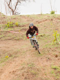 XC rider at the trail curve. XC rider turning right at trail curve. Cross-country cycling trail Stock Photography