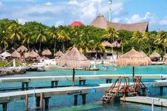Xcaret park, Mexico. XCARET, MEXICI - NOV 7, 2016: Beautiful beach of the Xcaret,  Maya civilization archaeological site, Yucatan Peninsula, Quintana Roo, Mexico Stock Photos
