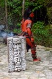Mayan people in Mexico. XCARET, MEXICO - NOV 8, 2015: Unidentified man with a red bodypaint as a Maya indian. Maya are a group of Indigenous people of Royalty Free Stock Image
