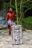 Mayan people in Mexico. XCARET, MEXICO - NOV 8, 2015: Unidentified man with a red bodypaint as a Maya indian. Maya are a group of Indigenous people of Stock Photos