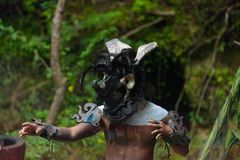 Mayan people in Mexico. XCARET, MEXICO - NOV 8, 2015: Unidentified man wears a costume of a Maya indian. The Mayan are a group of Indigenous people of Royalty Free Stock Photos
