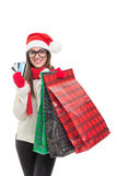 Xcited young woman Christmas shopping Stock Photos