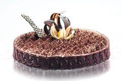 Xclusive-Tiramisu mit Kakao- und Schokoladendekoration auf die Oberseite, Stück des Sahnekuchens, Konditorei, Fotografie für Shop Stockbilder