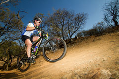 XCO National Competitor up a climb stock photography