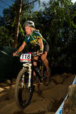 XCO Woman riding down Rock Garden section Stock Image