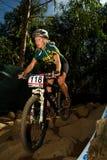 XCO Woman riding down Rock Garden section Stock Image