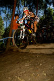 XCO Women Mountain biker taking off from drop off Royalty Free Stock Photo