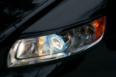 Xenon headlamp. Of black car Stock Photo