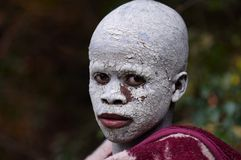 Xhosa boy undergoing ritual in South Africa. In one of the South African cultures, young men are forced to go through a rite of passage. This involved spending a Stock Photos