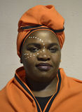 Xhosa woman in orange. South African woman in traditional Xhosa clothing stock photos