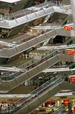 Xi'an, China: Kaiyuan Shopping Mall Escalators. Stainless steel escalators rise from floor to floor in soaring atrium of the upscale, modern Kaiyuan shopping Stock Image