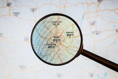Xi`an, China. Political map. City visualization illustrative concept on display screen through magnifying glass royalty free stock images