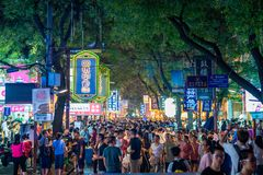 Crowded street with tourists in the Xi`an muslim quarter at night stock photo