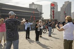 American tourists performing Tai Chi on old city wall, Xian, Chi. Xi`an, Shaanxi Province, China - September 8, 2018 : Group of American tourists performing Tai royalty free stock photo