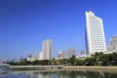 Xiamen city radio and television building near bridge Royalty Free Stock Photography