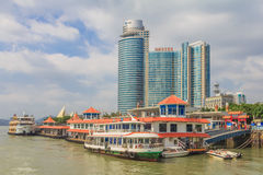 Xiamen skyline. Xiamen, China - September 14, 2013: Boats and skyscrapers on city skyline. Xiamen is an important and busy port city of China and ranks among the Stock Photo