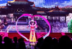 Chinese woman dancer showing her beautiful dance in the Tang Dynasty Dance Show in Xian, China royalty free stock photo
