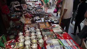 Xian, China - May 26, 2012: Unidentified people choose traditional souvenirs at the stall at the shopping street in Xian stock footage