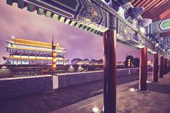 Xian city wall and ancient tower at night, China. Xian city wall and ancient tower at night, color toned picture, China stock image