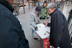 Xiangqi. Beijing, China - March 30th, 2013: Chinese men playing Chinese chess called Xiangqi on street in Beijing Stock Photography