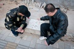 Xiangqi. Beijing, China - March 26th, 2013: two man playing Chinese chess called Xiangqi on street in Beijing Stock Photo