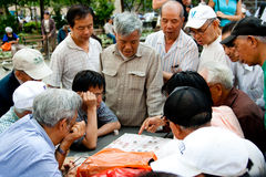 Xiangqi Chinese Chess players. Asian players playing a strategic board game like Chinese Chess, called Xiangqi in Columbus Park, China Town, Manhattan, New York Royalty Free Stock Photo