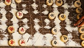 Xiangqi, or Chinese Chess, is a very popular game in Asian countries. Old wooden chess lines board chinese chess strategy game played royalty free stock photography