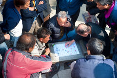 Xiangqi. HONG KONG - JANUARY 19, 2013: Group of people plaing xiangqi. Xiangqi, also called Chinese chess, is one of the most popular board games in China Royalty Free Stock Image